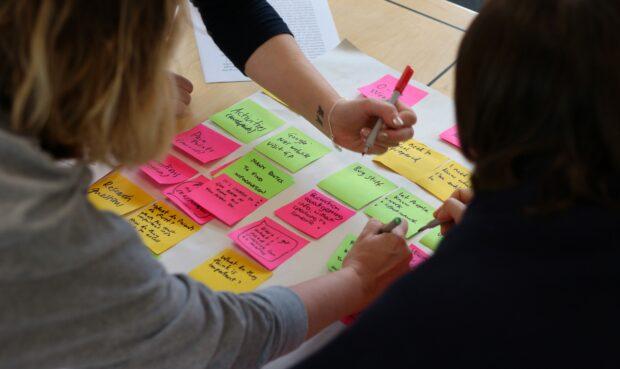 Civil servants working together to design a public service.