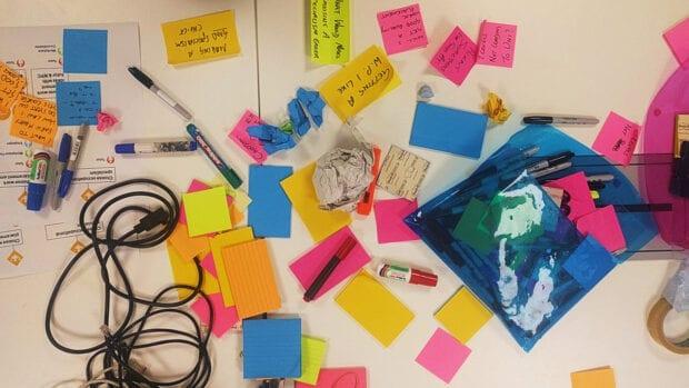 Stationary left on a desk after a design workshop